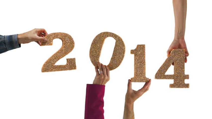 People holding the numbers 2014 in celebration of the new year.