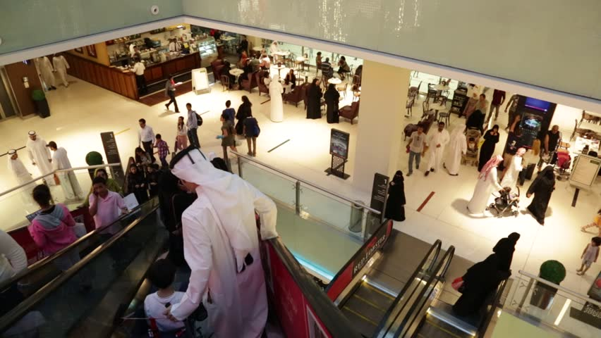 DUBAI, UAE - NOVEMBER 14: Shoppers at Dubai Mall on Nov 15, 2012 in Dubai. At over 12 million sq ft, it is the world's largest shopping mall based on total area and 6th largest by gross leasable area.