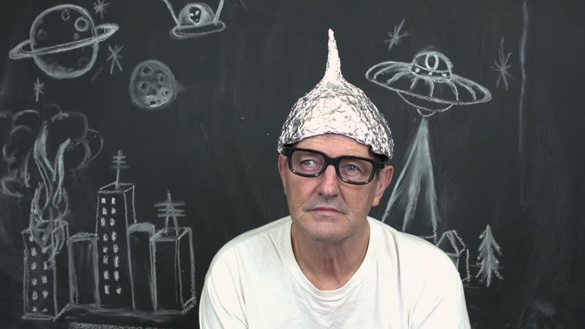 Paranoid elderly man with tinfoil helmet on