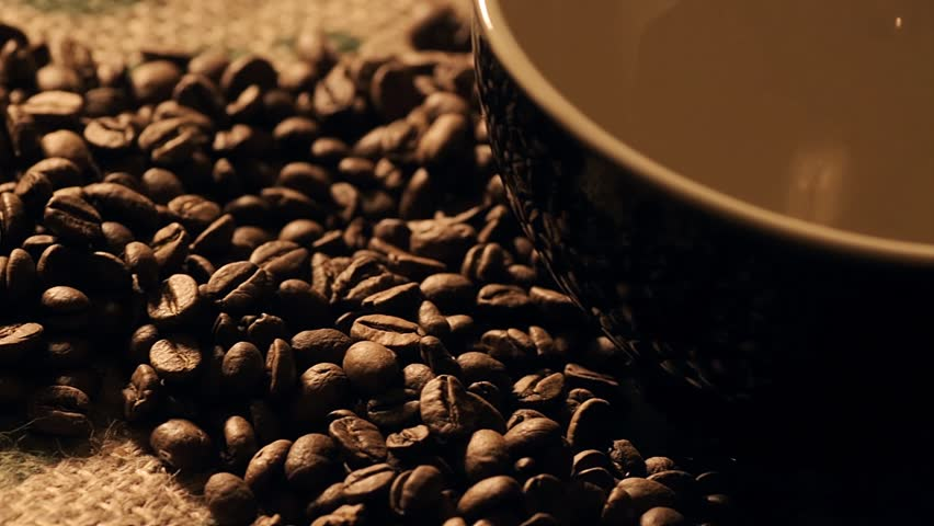camera panning over black coffee cup