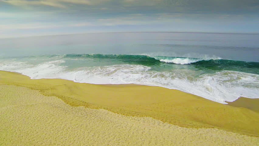 Ocean Waves Crashing on a Secluded Beach