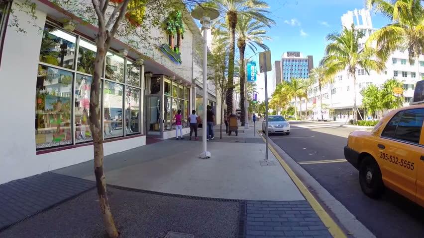 MIAMI - DECEMBER 03: Pedestrian POV footage of a person rollerblading on Washington Avenue in Miami Beach December 03, 2013 in Miami, USA.  | Shutterstock HD Video #5204747