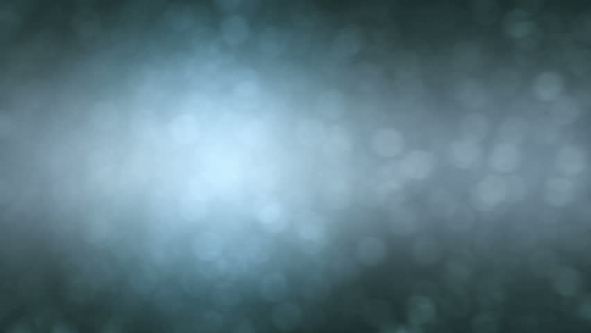 Abstract background of drifting blurred lights in a foggy atmosphere