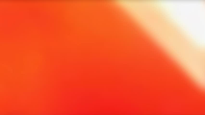 Film burn/light leak transition effect.