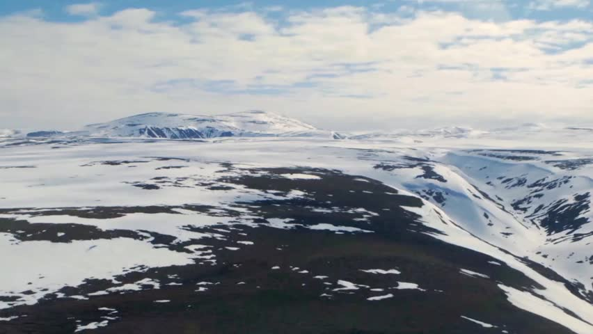Aerial view of a vast Arctic landscape with mountain ranges | Shutterstock HD Video #5226167