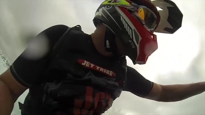 UNITED KINGDOM - CIRCA 2013: Jet ski tricks. POV from motorboat.