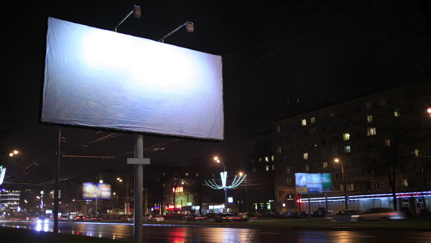 Time lapse of urban scene with an illuminated empty billboard on the side of a street with cars in motion and a block of flats in the background, by night | Shutterstock HD Video #5249714