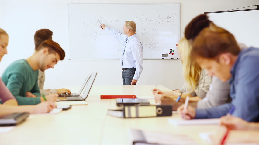 classroom whiteboard teacher. teacher in university explaining business economics on a whiteboard (full hd) stock footage video 5261207 | shutterstock classroom s