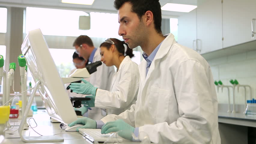 Team of serious science students working together in the lab at the university | Shutterstock HD Video #5276213