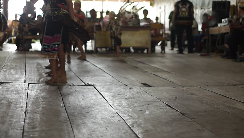 SAMARINDA, INDONESIA  CIRCA November 2013: Traditional Indonesian Dancers from Borneo (Pampang Village) perform the  Tari Sakai Nyelamai , Tari Ajay, Tari Enggang Terbang and Tari Berburu