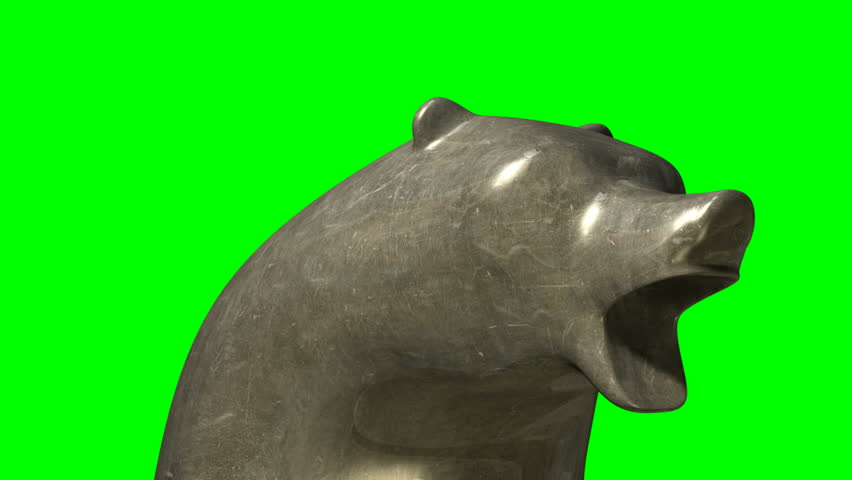 A closeup pan of two bronze castings depicting a stylized bear head in contrasting light representing a financial market trends on an isolated dark background | Shutterstock HD Video #5298191