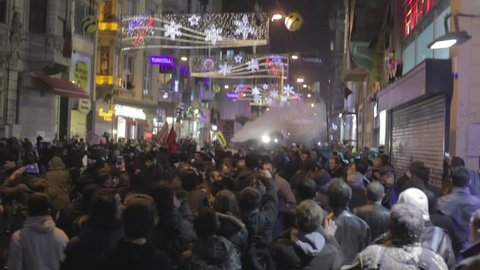 ISTANBUL, TURKEY – DECEMBER 27 2013: Turkish protestors clash with police during an anti-government protest in Istanbul