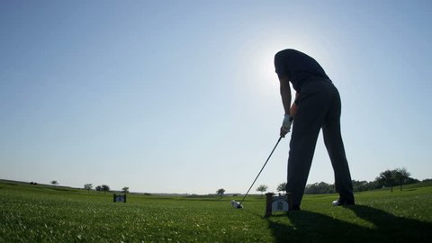 Weekend male golfer enjoying time golf course in summer driving off down fairway shot on RED EPIC, 4K, UHD, Ultra HD resolution