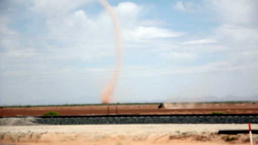 Extremely large and powerful dust devil shot from moving vehicle at 80 miles per hour
