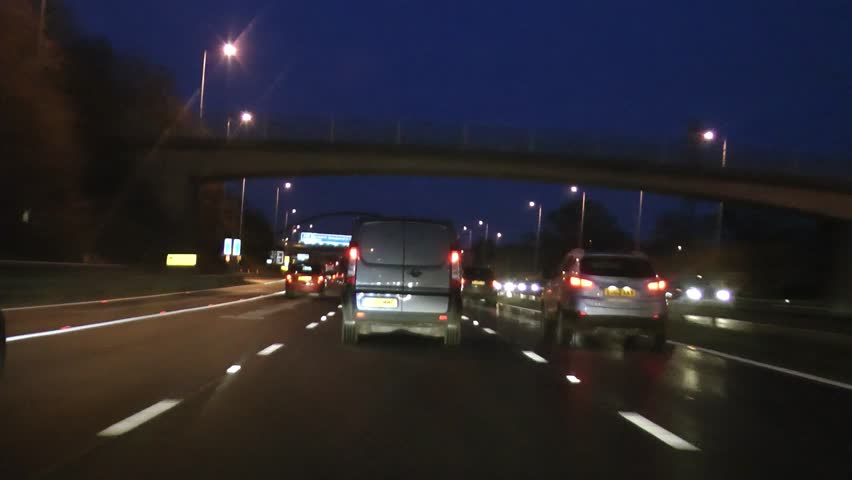 Congestion POV driving shot of car on motorway highway M42, M6 Midlands at night