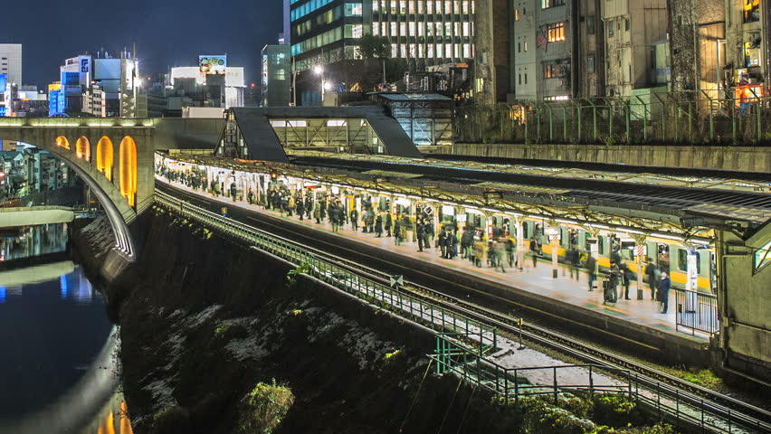 TOKYO 2013 - Nighttime time lapse of a busy train arriving at a train station in Tokyo, Japan
