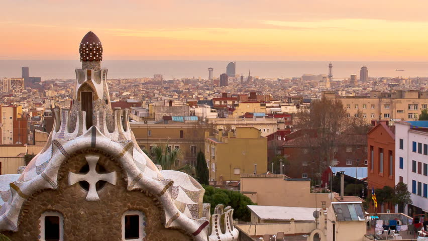 parc guell panorama zoom out of the city of barcelona,time lapse from sunset to night with the city lighting up park guell