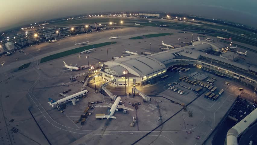 A timelapse clip of airport terminal shot from a control tower at sunset. | Shutterstock Video #5392802