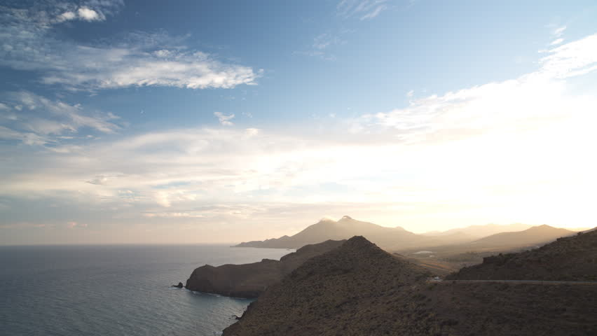 4k clip of beautiful day to night sunset time lapseover the sea in cabo de gata, spain