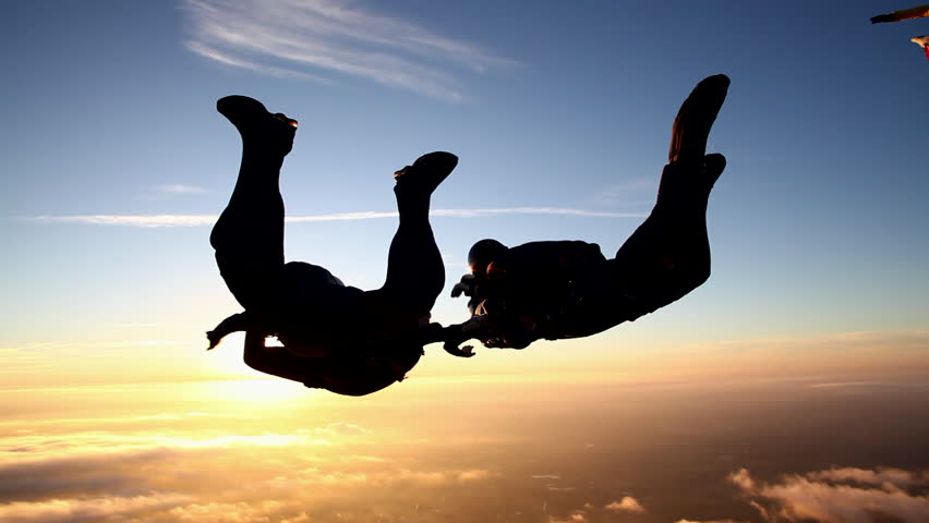 Skydiving formation at sunset | Shutterstock Video #5416694