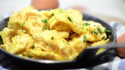 Portion of rotating Scrambles Eggs (full HD Video)