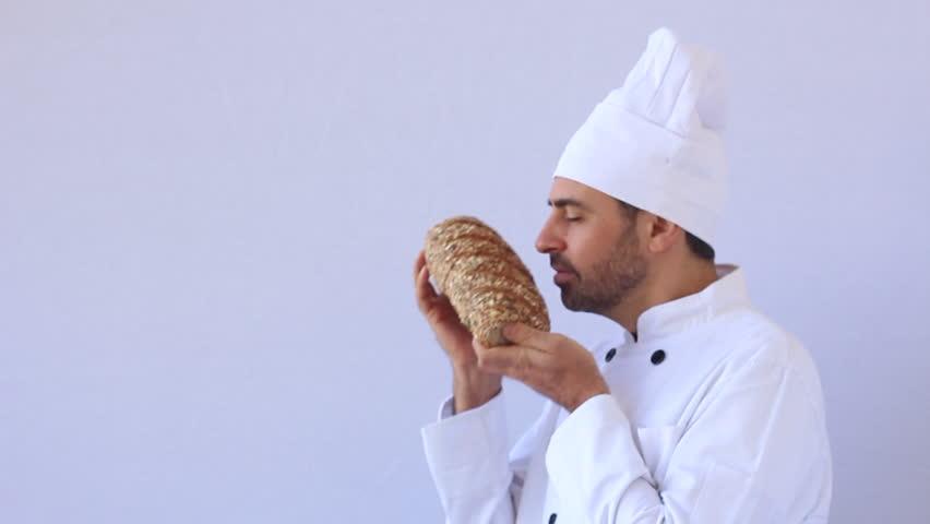 Baker hold up whole wheat bread   Shutterstock HD Video #5426396