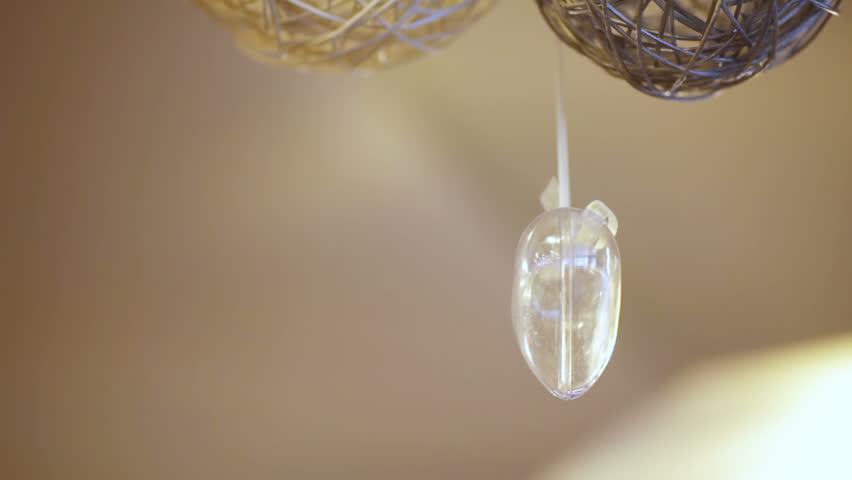 Hanging under ceiling transparent heart | Shutterstock HD Video #5430947