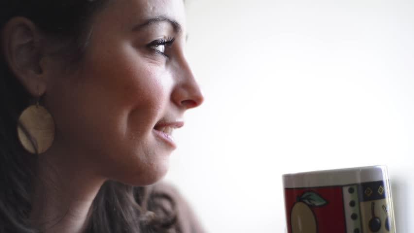 beautiful woman drinking coffee breakfast morning home