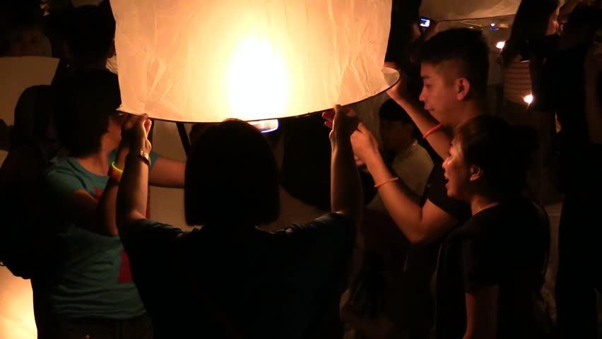CHAING MAI, THAILAND - CIRCA 2013: Lanna Kathina Celebration, Yee Peng Lanterns Festival, Mae Jo, Chiang Mai, Thailand, 2013.  Everybody must buy the lantern here. Lanterns from outside prohibited.