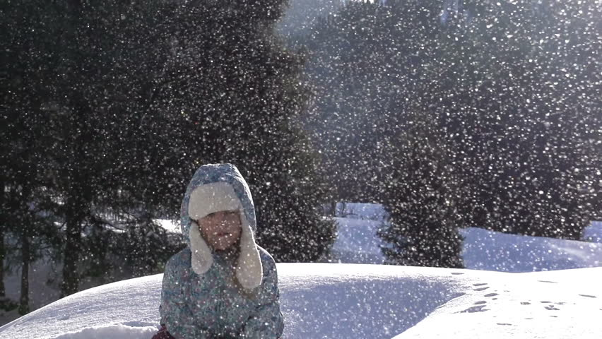 Girl and Snow. Girl throws fluffy snow on a background of a snowy landscape. Backlit sunlight. Slow Motion at a rate of 240 fps | Shutterstock HD Video #5448647