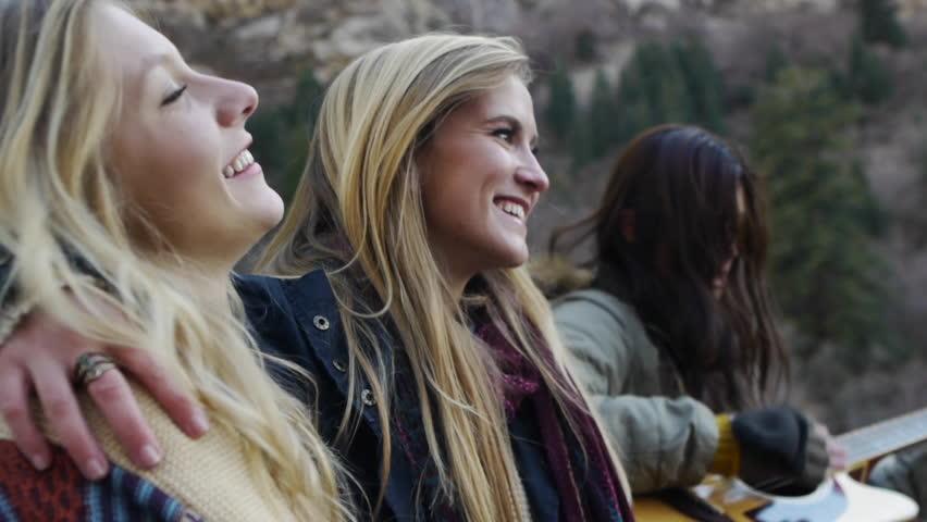 Girlfriend Hugs Girlfriend, Camera Surprises Another Girlfriend