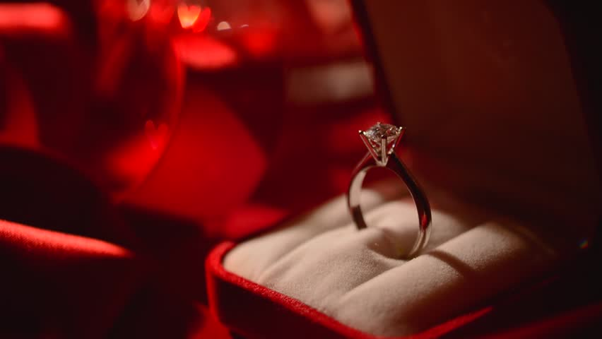 3670f8f15 Valentine's Day Gift. Marriage Proposal. Beautiful Ring - white gold with  big diamond (one carat) on red silk background. Rotation HD video footage