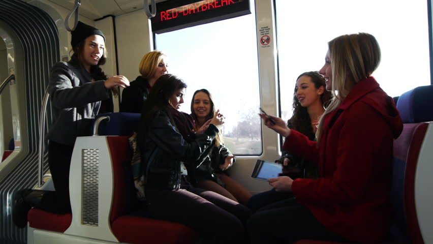 Six Lively Teen Girls And Their Phones On A Train