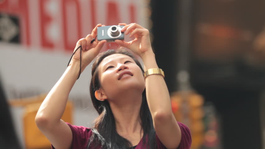 Woman Taking Photos of Busy Times Square, New York