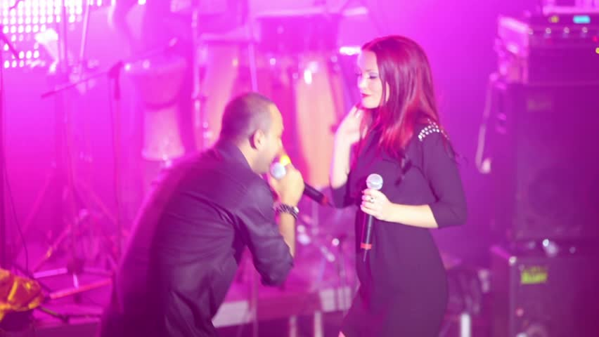 RUSSIA, MOSCOW - NOV 23, 2012: Singer of Arash with russian singer girl sing a song on stage at Arma Music Hall. #5485337