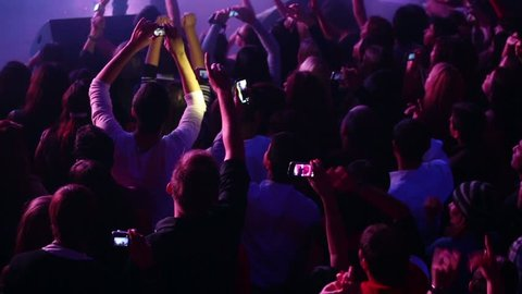 RUSSIA, MOSCOW - NOV 23, 2012: Crowd of spectators recording on cellphones the concert of Arash on stage at Arma Music Hall.