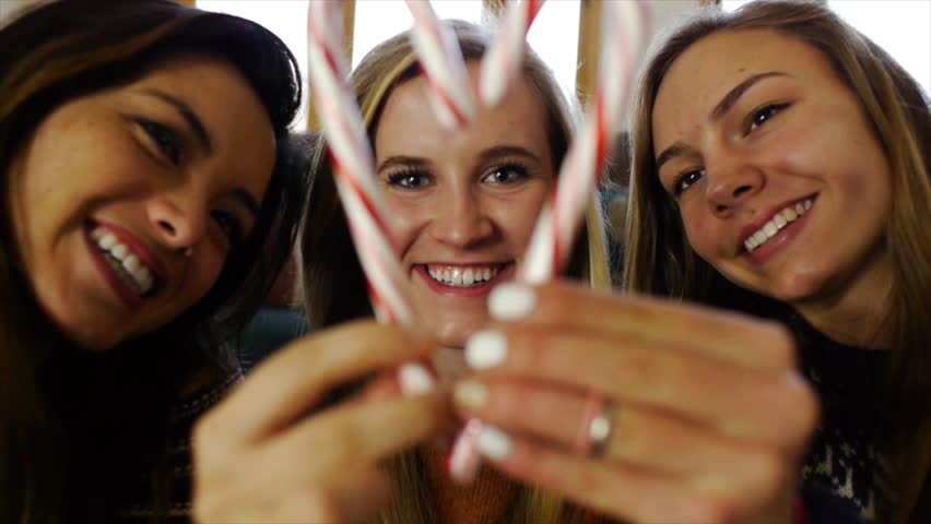 Teen Girl Framed By Friends In A Candy Cane Heart Blows A Kiss #5486387