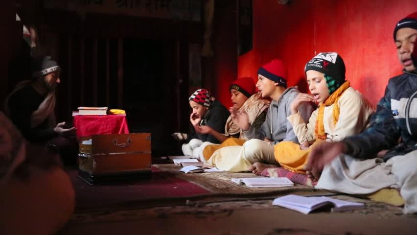 KATHMANDU, NEPAL - DEC 9: Unknown children during the reading of texts in Sanskrit at Jagadguru School, Dec 9, 2013 in Kathmandu, Nepal. School established at 2013 to let preserve Hindu culture. | Shutterstock HD Video #5516507