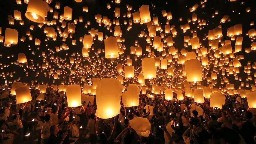SANSAI, CHIANGMAI, THAILAND - NOV 16: Thousand of sky lanterns release at Loi Krathong celebration during Yee Peng Festival in Chiangmai Mae Jo University, Thailand on November 16, 2013 | Shutterstock HD Video #5535164