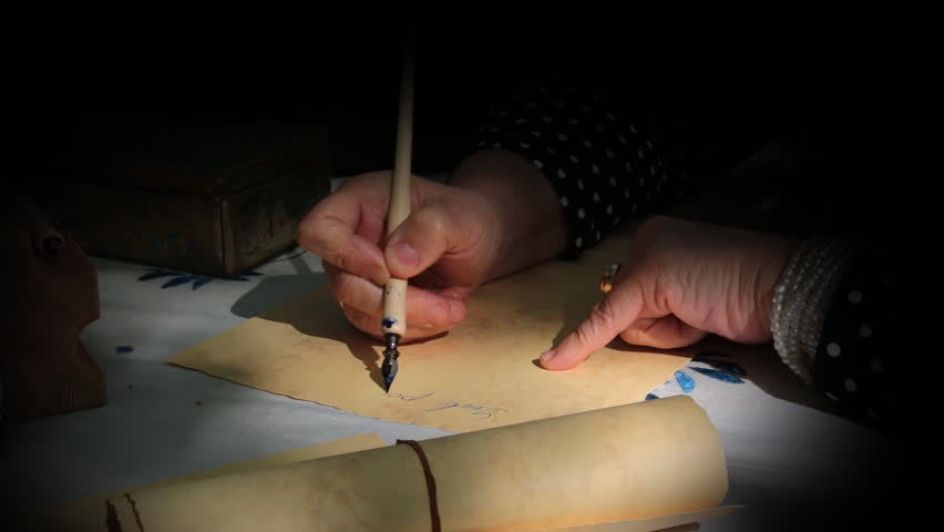 Woman with a pen begins to write a letter stock footage video vintage scene with spotlight where a woman is writing a letter or document with a dip altavistaventures Images