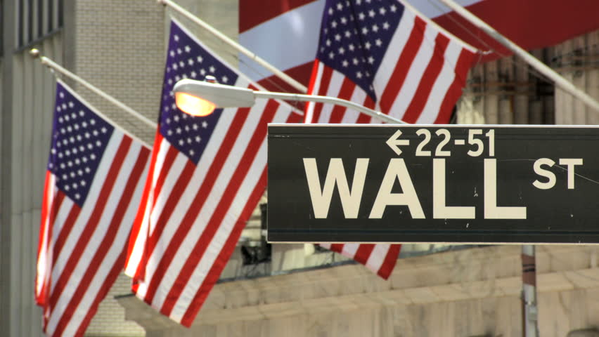 Street sign & American flags on Wall Street,New York City, USA