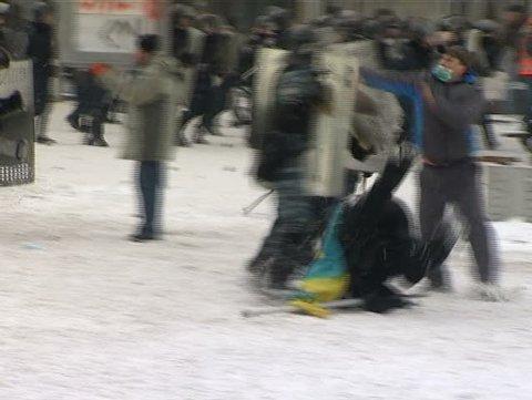 23, January, 2014, Ukrain, Kiev. Police disperse a crowd of rebels. Police beating