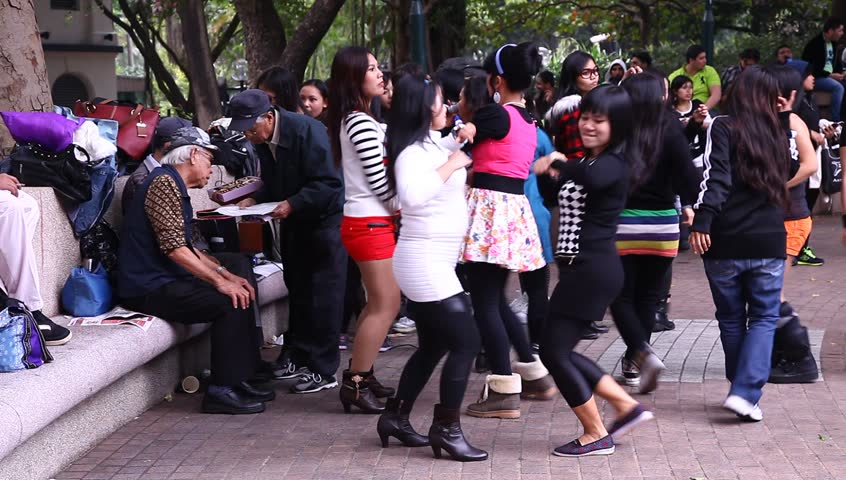 HONG KONG, SAR CHINA - JANUARY 12:   Indonesian maids dance in the park and hope to meet nice guys on Sunday afternoon, January 12, 2014.