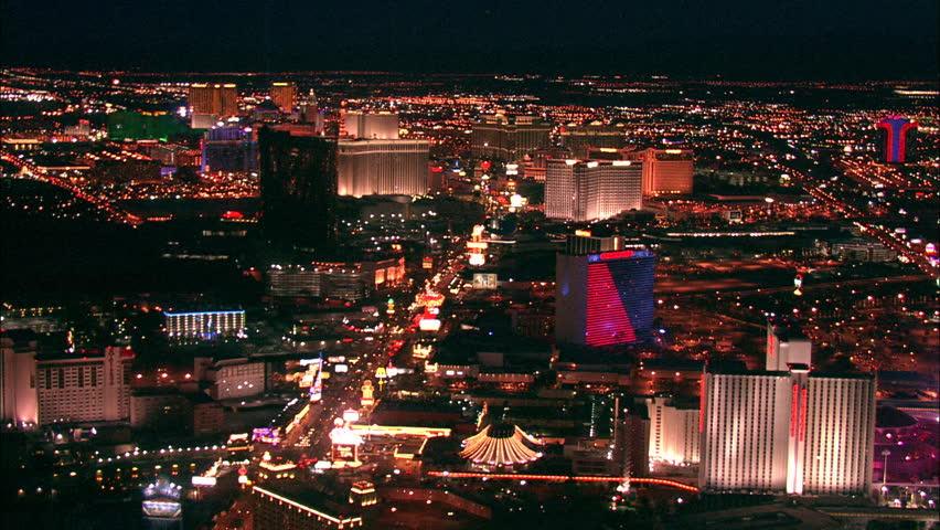 LAS VEGAS, USA - 1 January 2011 - Hotel Strip Night Las Vegas. Aerial footage of the Las Vegas strip at night. Beautiful hotel and skyscrapers light up the city skyline.   Shutterstock HD Video #5575397