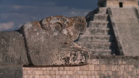 Mayan civilization in Mexico. Dolly shot of ruins Maya pyramids.Ancient Mayan snake eats pyramid