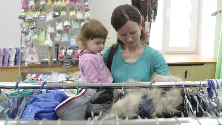 Mother and daughter shopping for clothes   Shutterstock HD Video #5580797