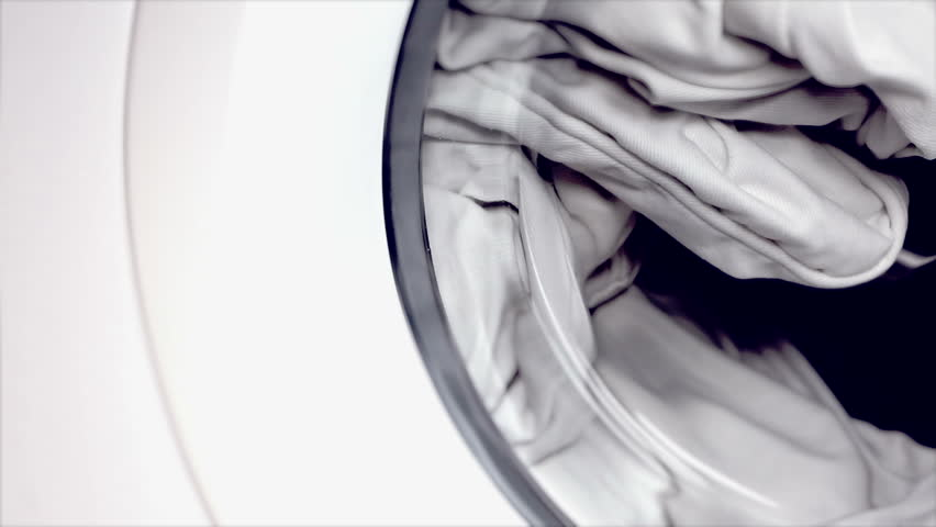 Doing the laundry with white item of underwear. | Shutterstock HD Video #5586644