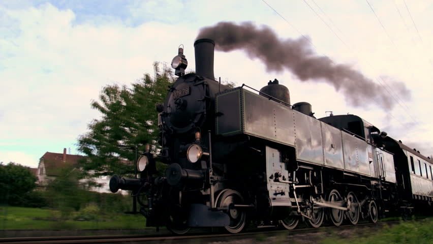 steam engine. old train locomotive. nostalgic technology. smoke puffing funnel. travel tourism attraction. 1920x1080. slow motion