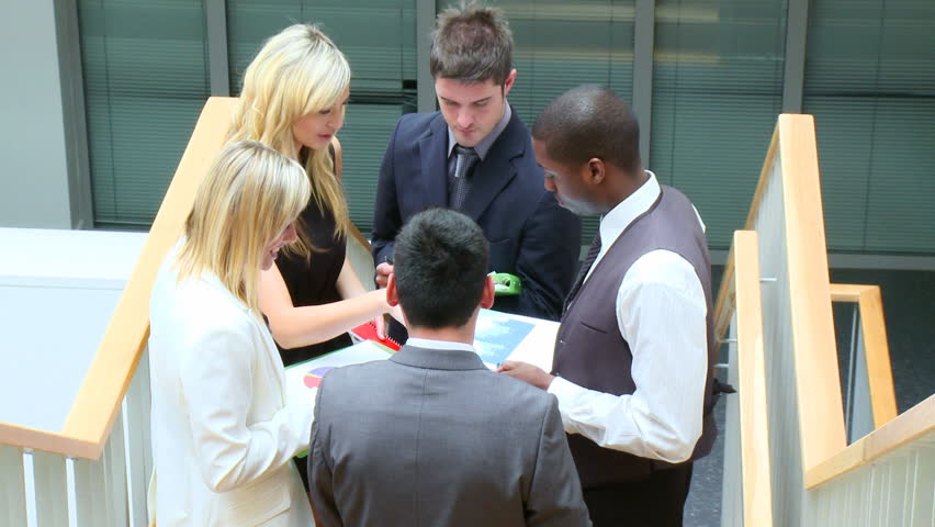 Business team discussing in corridor footage | Shutterstock HD Video #559864