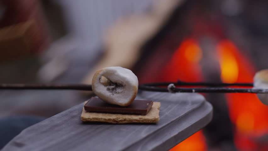 Making smores by outdoor fire. Shot on RED EPIC for high quality 4K, UHD, Ultra HD resolution.